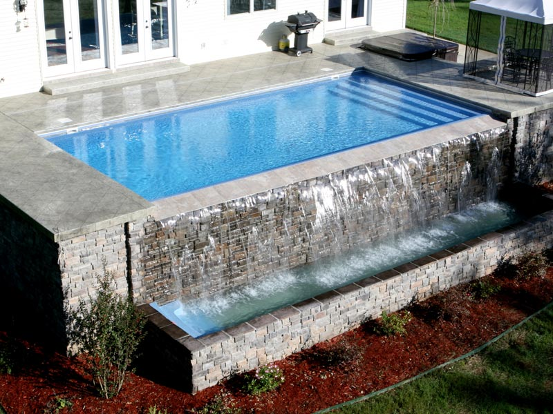The aqua group fiberglass pools spas vanishing edge for Pool negative edge design
